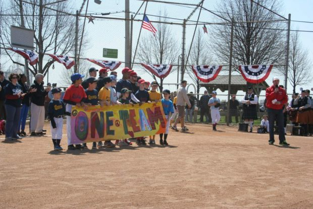 Savin Hill Little League, Martin Richard's team, with its One Team banner. Image via Dot Art (Facebook)