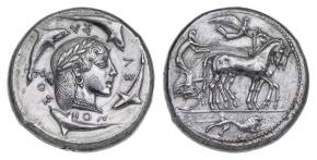 top billing goes to the Dekadrachm (Demareteion) of Syracuse with quadriga, about 465 BC. This is the most famous coin in the room.